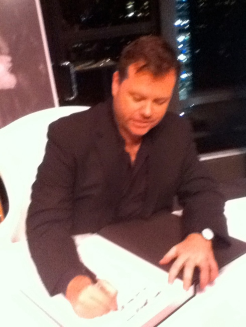 Author John Tiffany, signing Eleanor Lambert: Still Here